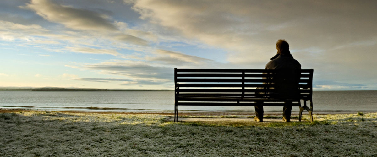 Man sitting on a bench in need of counselling